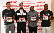 Donavan Brazier (left), Boris Berian (second from left), Christian Coleman (second from right) and Noah Lyles pose with bib numbers during a  press conference prior to the New Balance Indoor Grand Prix in Boston on Friday, Feb. 9, 2018.