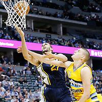 10 April 2016: Utah Jazz center Rudy Gobert (27) is fouled by Denver Nuggets center Nikola Jokic (15) during the Utah Jazz 100-84 victory over the Denver Nuggets, at the Pepsi Center, Denver, Colorado, USA.
