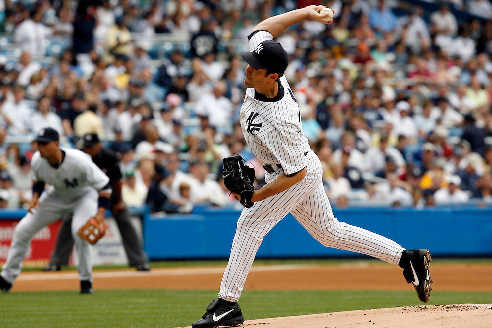 Mike Mussina of the New York Yankees pitches against the Florida Marlins in the first inning at Yankee Stadium, Bronx, New York, Sunday 25 June 2006. (Andrew Gombert for the New York Times)