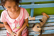 27 JUNE 2006 - SIEM REAP, CAMBODIA: CHAN TREA, 9, who lost her leg because of a birth defect, waits to be fitted with a prosthesis at Handicap International in Siem Reap, Cambodia. Handicap International helps Cambodians maimed by mines and unexploded ordinance as well as traffic accidents and disease adjust to a life without limbs. Cambodians are still wrestling with the legacy of the war in Vietnam and subsequent civil wars. At one time it was the most heavily mined country in the world and a vast swath of Cambodia, along the Thai-Cambodian border, is still mined. In 2004, more than 800 people were killed by mines and unexploded ordinance still found in the countryside.  Photo by Jack Kurtz