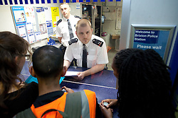 © Licensed to London News Pictures . 21/08/2012 . London , UK . Video has emerged of a man being detained in Brixton on Sunday ( 19th August ) during which it is alleged police officers stamped on the  man's head . Protesters march from Lambeth Town Hall to Brixton police station and deliver a formal complaint about the incident to the front counter . Photo credit : Joel Goodman/LNP