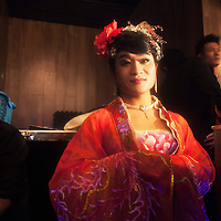 BEIJING, NOVEMBER -24 : a transvestite entertainer in an underground lesbian club in Beijing waits for his turn.