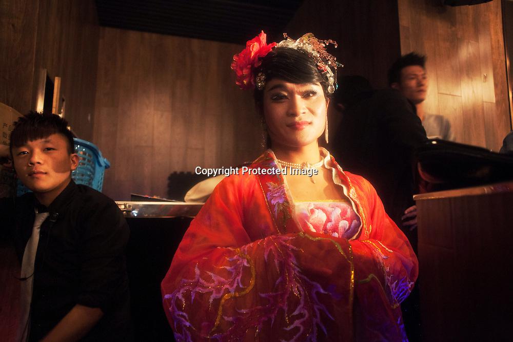 BEIJING, NOVEMBER -24 : a transvestite entertainer in an underground lesbian club in Beijing waits for his turn.