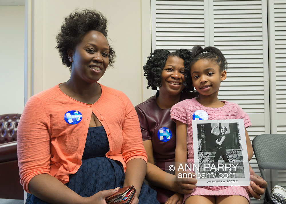 Garden City, New York, USA. April 17, 2016. L-R, TORESHA PETERSON, JOANNE VANTERPOOL and, her 7-year-old daughter JORDAN VANTERPOOL, all from Hempstead, are campaign volunteers for Democratic presidential primary candidate Hillary Clinton, and are attending the Canvass Kickoff at the Nassau County Democratic Office, part of the GOTV Get Out The Vote for Hillary four day weekend event.