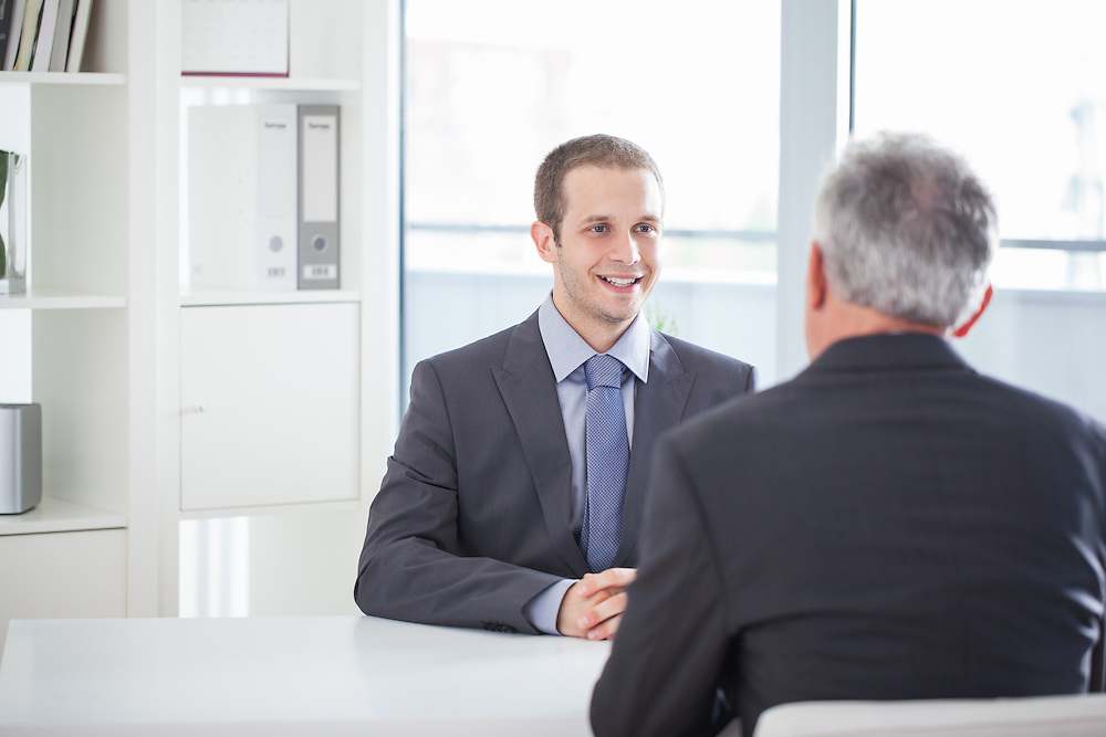 Smiling candidate during a job interview.