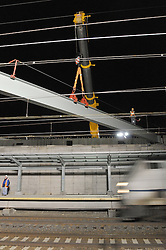 Train Movement at Night Bridge Steel Pick over Northeast Corridor Tracks. Construction of the Railroad Station at Fairfield Metro Center, Connecticut.