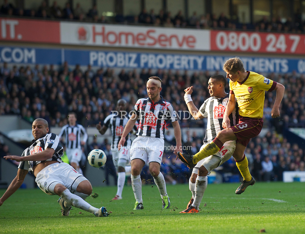 WEST BROMWICH, ENGLAND - Saturday, March 19, 2011: Arsenal's Andrei Arshavin sees his shot blocked by West Bromwich Albion's Steven Reid during the Premiership match at the Hawthorns. (Photo by David Rawcliffe/Propaganda)