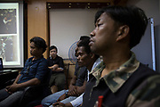 A Maniq man called Yaaw attends a meeting inside the Trang city Municipal Hall. The meeting was organised during the research trip by The National Human RIghts Commission of Thailand who were discussing the process of the Maniq obtaining citizenship.<br /> <br /> Evidence suggests that the Maniq, a Negrito tribe of hunters and gatherers, have inhabited the Malay Peninsula for around 25,000 years. Today a population of approximately 350 maniq remain, marooned on a forest covered mountain range in Southern Thailand. Whilst some have left their traditional life forming small villages, the majority still live the way they have for millennia, moving around the forest following food sources. <br /> <br /> Quiet and reclusive they are little known even in Thailand itself but due to rapid deforestation they are finding it harder to survive on the forest alone and are slowly being forced to move to its peripheries closer to Thai communities.