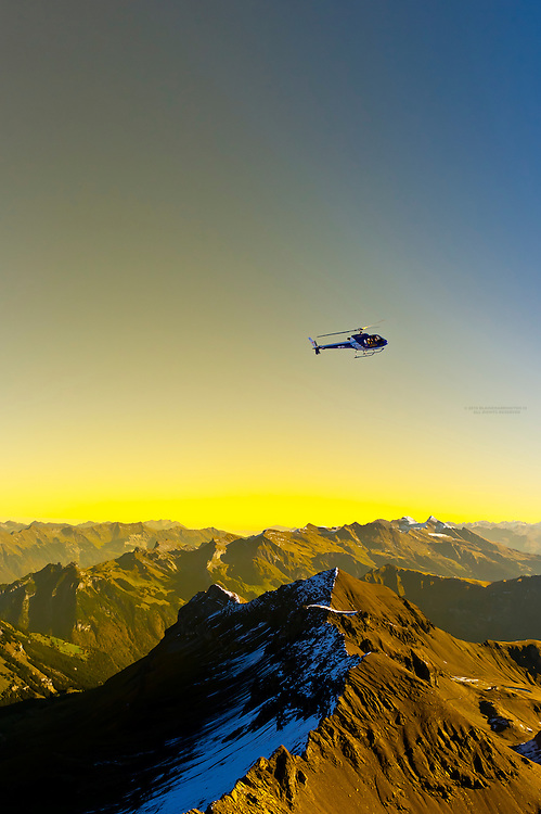 A helicopter landing at Piz Gloria atop the Schilthorn in the Swiss Alps, Canton Bern, Switzerland