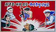 A propaganda poster in Chongsan-ri  primary school, Pyongyang, North Korea.<br /> -What&rsquo;s written on this board please?<br /> -&laquo;It is exciting to play soldier and to kill the Americans&raquo;. Mr Eric, Americans have teased us for a long time. That&rsquo;s why we always give an anti-american education to our kids.