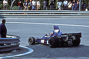 Frenchmen Patrick Depallier handles his Tyrrell-Ford during the training sessions of the 1975 Spanish Grand Prix