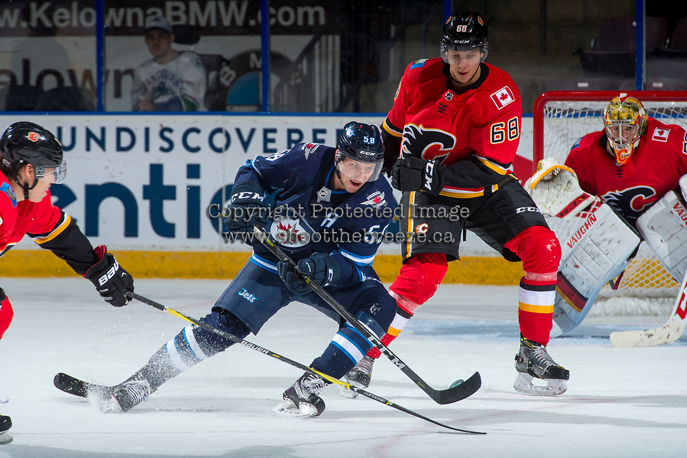 PENTICTON, CANADA - SEPTEMBER 11: Jansen Harkins #58 of Winnipeg Jets handles the puck ahead of Adam Ollas Mattsson, #68 of Calgary Flames on September 11, 2017 at the South Okanagan Event Centre in Penticton, British Columbia, Canada.  (Photo by Marissa Baecker/Shoot the Breeze)  *** Local Caption ***