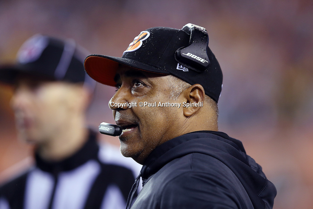 Cincinnati Bengals head coach Marvin Lewis talks on his headsets on the sideline during the NFL AFC Wild Card playoff football game against the Pittsburgh Steelers on Saturday, Jan. 9, 2016 in Cincinnati. The Steelers won the game 18-16. (©Paul Anthony Spinelli)