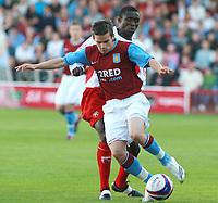 Photo: Mark Stephenson.<br /> Walsall v Aston Villa. Pre Season Friendly. 07/08/2007.Villa's Zoltoan Stieber on the ball and Walsall's Edrissa Sonko