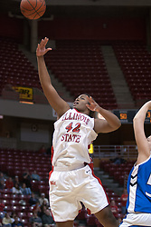 26 February 2006:  LaShawn Johnson applies a slight hook to head this ball towards the hoop.....Illinois State Redbirds out muscled the Creighton Bluejays on Senior day by a score of 75-61.  Senior Holly Hallstorm grabbed her 10th double double with 20 points and 12 rebounds.  Competition took place at Redbird Arena on Illinois State University campus in Normal Illinois.