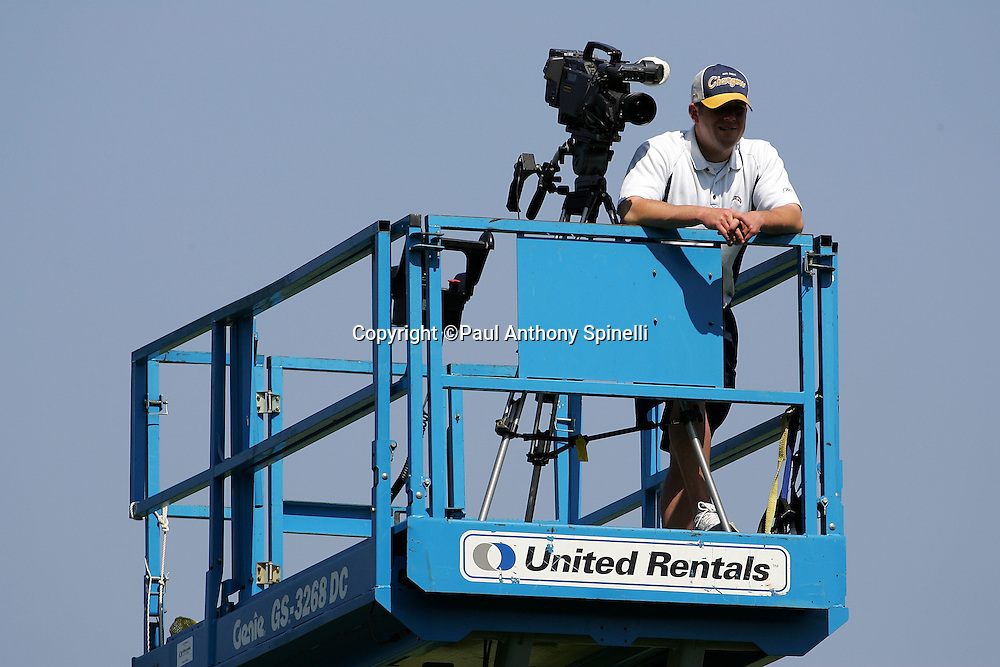 SAN DIEGO - JUNE 10:  A video camera tapes the workouts while riding high on a platform overlooking the San Diego Chargers mini camp at Chargers Park on June 10, 2006 in San Diego, California. ©Paul Anthony Spinelli