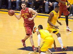 Iowa State Cyclones forward Georges Niang passes the ball up the floor against the West Virginia Mountaineers during the first half at the WVU Coliseum.