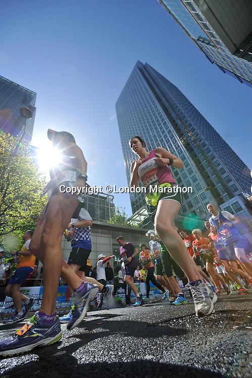 Picture by David Ashdown  London Marathon 2014. 13/4/14. Picture by David AshdownRunners pass through Canary Wharf.<br /> The Virgin Money London Marathon 2014<br /> 13 April 2014<br /> Photo: David Ashdown/Virgin Money London Marathon<br /> media@london-marathon.co.uk