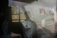 Napoli, Italia - 16 gennaio 2013. L'interno di un treno della ferrovia Circumvesuviana che ha subito atti vandalici (è stato riversato all'interno della cabina di pilotaggio il contenuto di un estintore). La storica linea ferrata che collega il capoluogo partenopeo con l'hinterland è risultata, secondo un rapporto di Legambiente, la peggior linea ferrata d'Italia. Ogni giorno migliaia di pendolari subiscono ogni genere di disservizio: dai ritardi, alla mancanza di treni agli scambi rotti..Ph. Roberto Salomone Ag. Controluce.ITALY - A view of the inside of  train of the Circumvesuviana railway in Naples on January 16, 2013 that has been devastated by vandals (a fire extinguisher was used to destroy the electric panels of the cockpit). The historic railway connects Naples to its suburbs. According to a Legambiente report, the Circumvesuviana railway is Italy's worst. Every day thousands of commuters suffer every kind of disservice.