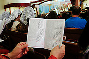 The Mass guide in English and Chaldean during an ordination at St. Peter Chaldean Catholic Cathedral in El Cajon, Calif., Aug. 14, 2015. (Nancy Wiechec for ONE magazine)