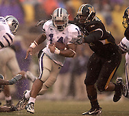 Kansas State running back Leon Patton (14) rushes up field past a Missouri defensive end Xzavie Jackson (48) in the second half at Faurot Field in Columbia, Missouri, October 21, 2006.  The Tigers beat the Wildcats 41-21.<br />