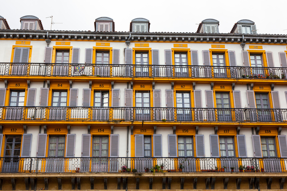 Numbered apartments on Plaza de la Constitución, San Sebastian Donostia, Euskadi, Spain. Constructed in 1817, by architect Ugartemendia, the numbers mark the boxes that the buildings used to house for watching bullfighting.
