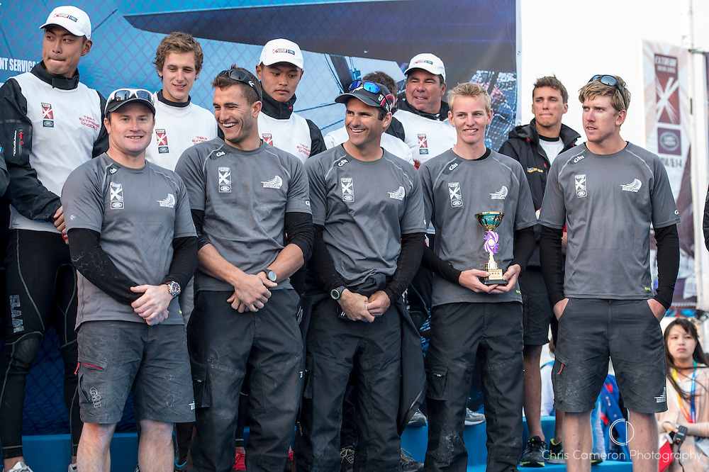 Emirates Team New Zealand sailors, Glenn Ashby, Blair Tuke, Jeremy Lomas, Edwin De Latt and Peter Burling on stage at the prize giving to receive the third place trophy for the Land Rover Extreme Sailing Series regatta in Qingdao, China. 4/5/2014