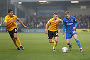 AFC Wimbledon attacker Marcus Forss (15) dribbling and taking on Southend United defender Jason Demetriou (24) and Southend United midfielder Timothee (Tim) Dieng (8) during the EFL Sky Bet League 1 match between AFC Wimbledon and Southend United at the Cherry Red Records Stadium, Kingston, England on 1 January 2020.