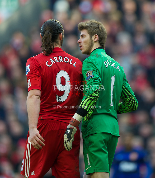 LIVERPOOL, ENGLAND - Saturday, January 28, 2012: Liverpool's Andy Carroll in action against Manchester United's goalkeeper David de Gea during the FA Cup 4th Round match at Anfield. (Pic by David Rawcliffe/Propaganda)