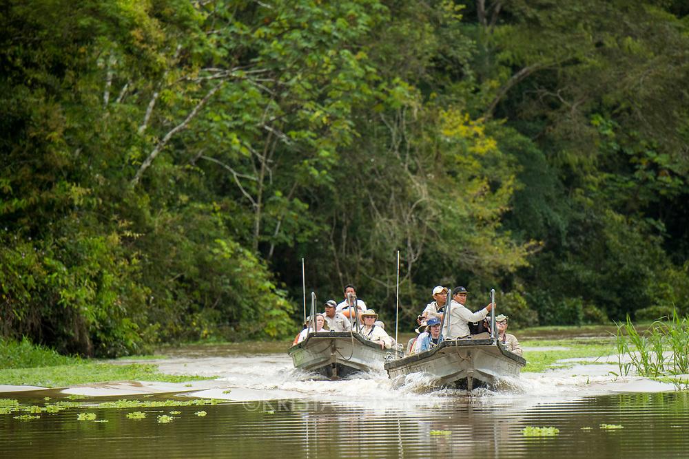 Two skiffs motor along Pahuachiro Caño after a morning wildlife watching excursion. Pacaya Samiria National Reserve, Upper Amazon, Peru.