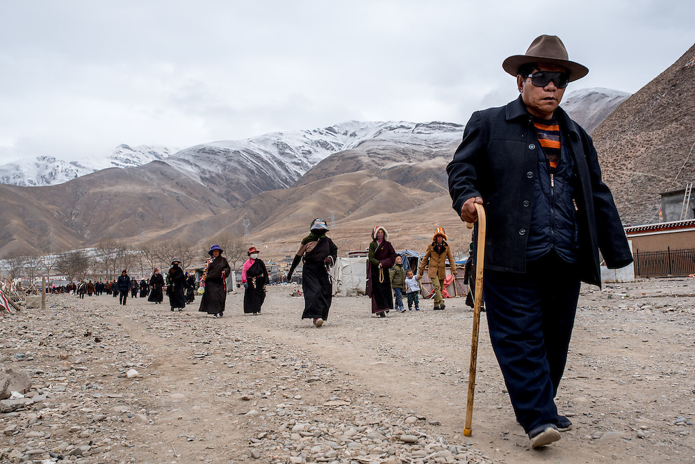 Tibetans walk loops around the Gyanak mani wall in Yushu prefecture, Tibet (Qinghai, China).