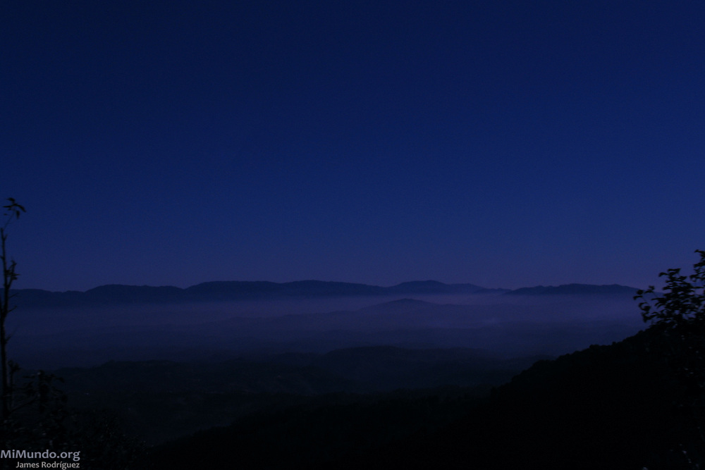 Panorama of the Cuchumatanes Sierra at dawn as seen from the Pan-American highway near Malacatancito. The Cuchumatanes are the highest and most extensive non-volcanic mountain range in Central America with elevations ranging from 500 meters to over 3,800 meters above sea level. Numerous biomes, or ecosystems, found in the Cuchumatanes are unique within Central America. Malacatancito, Huehuetenango, Guatemala. January 27, 2005.
