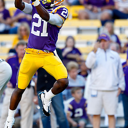 October 16, 2010; Baton Rouge, LA, USA; LSU Tigers wide receiver Chris Tolliver (21) during warm ups prior to kickoff against the McNeese State Cowboys at Tiger Stadium. LSU defeated McNeese State 32-10. Mandatory Credit: Derick E. Hingle