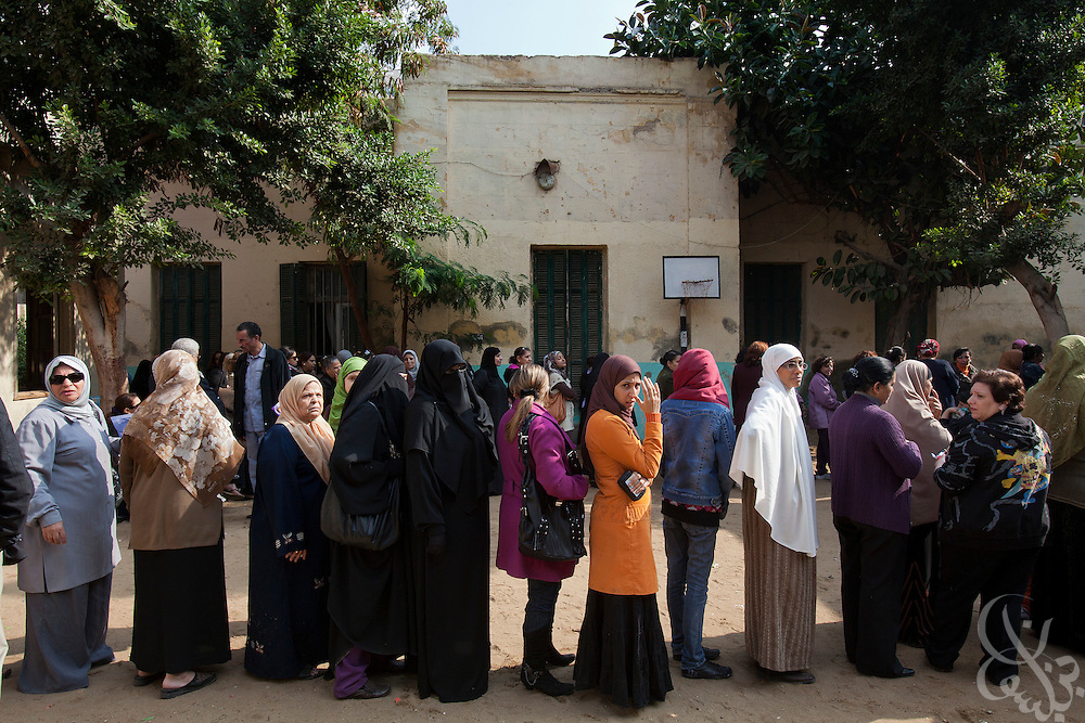 Egyptian Women cue in line for their chance to vote in the first round of historic free parliamentary elections Nov 28, 2011 at a polling station in the Shubra district of the capital, Cairo. The election, the first since the revolution in Egypt that ousted former president Hosni Mubarak earlier in the year, is seeing very high voter turnout and is hoped to be a positive step in the direction of a new democratic spirit for the country. (Photo by Scott Nelson)
