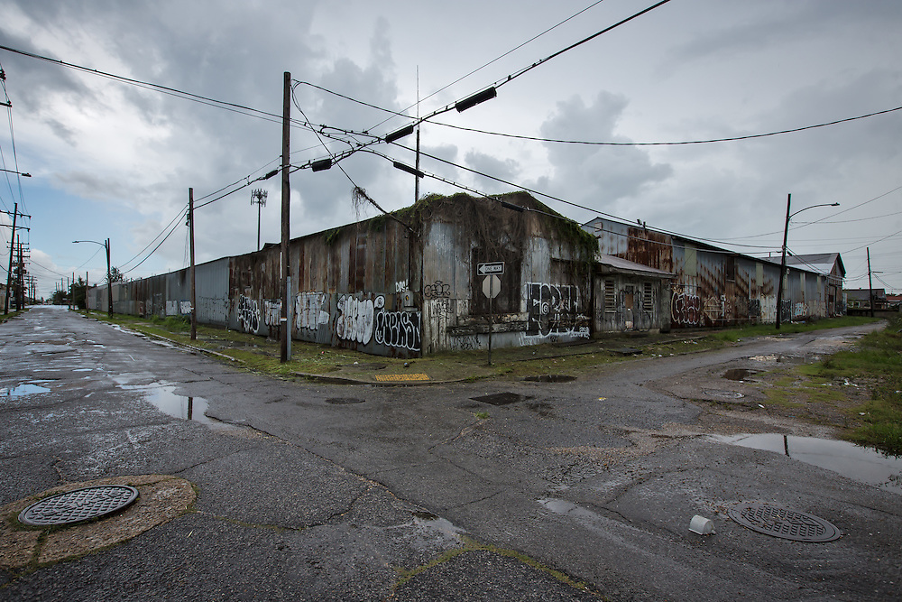 June 14, 2015, New Orleans, LA, building overgrown with vines and covered in graffiti , almost ten years after Hurricane Katriana.
