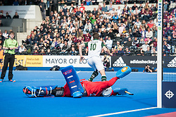 Surbiton's David Beckett scores the winning goal in the shoot out. Wimbledon v Surbiton - Men's Hockey League Final, Lee Valley Hockey & Tennis Centre, London, UK on 23 April 2017. Photo: Simon Parker