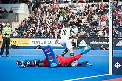 Surbiton's David Beckett scores the winning goal in the shoot out. Wimbledon v Surbiton - Men's Hockey League Final, Lee Valley Hockey & Tennis Centre, London, UK on 23 April 2017. Photo: Simon Parker