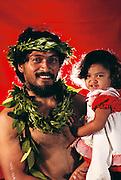 Hawaiian man and child. Hula contest in Hilo, on the Big Island, Hawaii. USA. MODEL RELEASED.