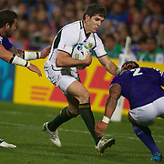 Jaque Fourie, South Africa, is tackled by Mahanri Schwalger, Samoa,  during the South Africa V Samoa, Pool D match during the IRB Rugby World Cup tournament. North Harbour Stadium, Auckland, New Zealand, 30th September 2011. Photo Tim Clayton...