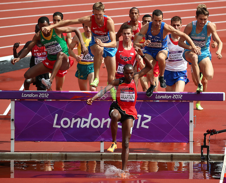 Jacob Araptany of Uganda leads the pack during a heat for the men's 3000m Steeplechase during track and field at the Olympic Stadium during day 6 of the London Olympic Games in London, England, United Kingdom on August 3, 2012..(Jed Jacobsohn/for The New York Times)..