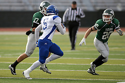 15 November 2014:  Brinton Wilkey and Zach Till track down M. Hawkins during an NCAA division 3 football game between the North Park Vikingsand the Illinois Wesleyan Titans in Tucci Stadium on Wilder Field, Bloomington IL