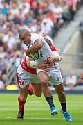Twickenham, Surrey, World Cup, Sunday, Sunday, 11/08/2019  2019 World Cup, Warm up match, Quilter International, England vs Wales, at the RFU Stadium  [© Peter SPURRIER/Intersport Image]<br /> <br /> 14:07:40 Jonathan Joseph of England, tackled by Hadleigh Parkes of Wales