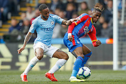 Manchester City midfielder Raheem Sterling (7) challenges Crystal Palace forward Wilfried Zaha (11) during the Premier League match between Crystal Palace and Manchester City at Selhurst Park, London, England on 14 April 2019.