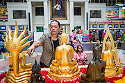 17 APRIL 2013 - BANGKOK, THAILAND:   Thais make merit by bathing statues of the Buddha in the main hall at Hua Lamphong Train Station in Bangkok before traveling at the end of Songkran. Songkran, the traditional Thai New Year, is the busiest time of the year for Thai domestic travel. Many people in Bangkok return to their home provinces for the holiday and some people in the provinces travel to Bangkok for the holiday. Songkran, usually a three day holiday, was five days this year because the official days on the weekend. Trains and buses coming into Bangkok were reported to be fully booked and the State Railway of Thailand added extra trains and carriages to accommodate the crowds.   PHOTO BY JACK KURTZ