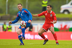 REYKJAVIK, ICELAND - Wednesday, May 28, 2008: Wales' Lewin Nyatanga and Iceland's Stefan Thordarson during the international friendly match at the Laugardalsvollur Stadium. (Photo by David Rawcliffe/Propaganda)