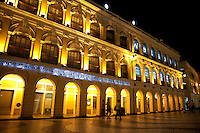 Waves are formed by black and white mosaic tiles flanked by classic portuguese colonial architecture in Senado Square Macau.