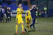 Wimbledon players applaud the fans at full time during the EFL Sky Bet League 1 match between Tranmere Rovers and AFC Wimbledon at Prenton Park, Birkenhead, England on 21 December 2019.