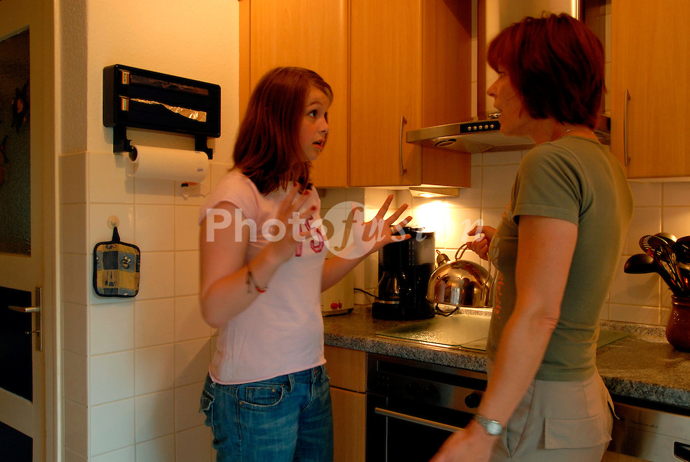 Mother arguing with teenage daughter in the kitchen
