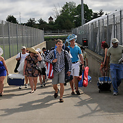 Racing fans enter the infield prior to the first race on Kentucky Derby Day in Louisville, Kentucky May 5, 2012.