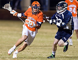 Virginia Cavaliers M/A John Haldy (12) is defended by Mt. Saint Mary's  M Nick Raines (33).  The #2 ranked Virginia Cavaliers defeated the Mt. Saint Mary's Mount 10-2 at the University of Virginia's Klockner Stadium in Charlottesville, VA on February 24, 2009.   (Special to the Daily Progress / Jason O. Watson)